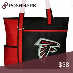 Atlanta Falcons Purse Show your spirit with this officially licensed carryall bag/purse. Made of microfiber material in Red and Black in color. Embroidered team logo on front. Right over the team logo is an open pocket, great for ipad or book. Double straps. Double inner lining. Top zipper closure to open main compartment. Inside side pocket. Size: 13inW x 10.5inH x 4.25inD. This is not a large tote makes a good shoulder purse. Bags Shoulder Bags