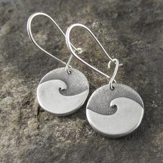 Handmade simple cresting wave darkened sterling silver dangle earrings by Beth Millner Jewelry. Handcrafted nature inspired modern earrings from recycled metal.
