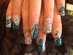 Full set of acrylic with Swarovski crystals on ring with nail art on rest xxx