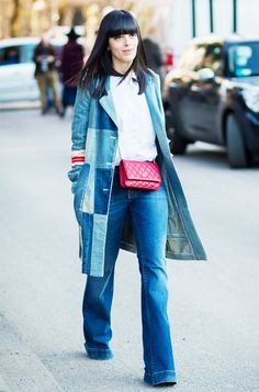 Laura Comolli wears a white blouse, denim patchwork coat, flare jeans, and a crossbody Chanel bag