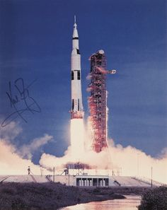 Saturn V Launch Photo, signed by Neil Armstrong.