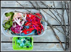 Ribbon, gems, and branches for an outdoor Reggio inspired art activity. From My Nearest and Dearest.