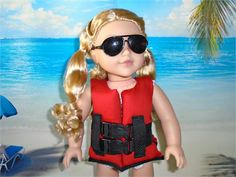 18 inch doll fitting clothes for boy or girl doll. American hand made.  Cherry Red life vest. It has plastic clasping buckles in the front, filled with foam and trimmed with black double bias tape. All strapping has been heat sealed on the ends. Duck outside fabric.  *Not an actual working life vest. Please dont get your doll wet. Life vest is for pretend play only. Because of the bounce in the foam, a young child may need help getting it on the doll.  SUNGLASSES AND SWIMSUIT ARE NOT…