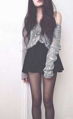 black high waisted skirt, grey thin wooly over the shoulder sweater tucked into skirt, and black tights.