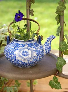 "Spending money on fancy pots isn't necessary.  Look around the house for ""unique places"" to plant your flowers.  This tea pot is so adorable!"