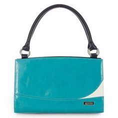 """Ashton  Unique patent turquoise faux leather makes the Ashton a delightful addition to your Miche Classic Shell collection. She evokes dreams of afternoons sailing on crystal-clear waters and cocktails at the country club-but really-her sophisticated styling makes her the perfect choice for any setting! Note the stylish """"white wave"""" accent-you'll get compliments wherever you go . . ."""