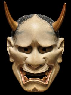 Japanese mask is used for Noh play. It represents woman with anger.