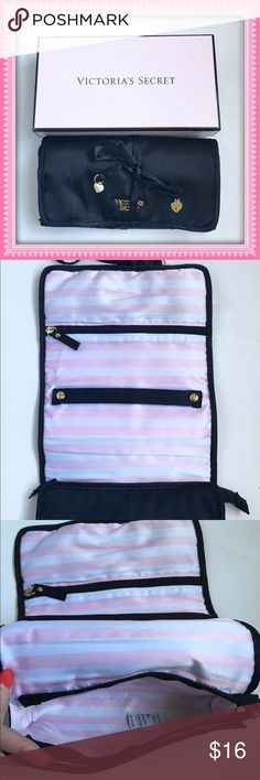 Victoria's Secret Jewelry Travel Bag NWT  Don't let your jewelry get tangled at the bottom of a suitcase anymore! Black satin organizer with pink and white satin lining. Gold tone VS logo on front. Interior has 1 zip pocket, 1 zip pouch pocket, and ring/bracelet holder. Rolls up and ties closed keeping your jewelry organized. NEW IN BOX. MAKES A GREAT GIFT  Victoria's Secret Bags
