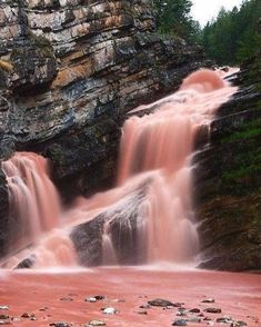 Canada is home to a real pink waterfall and it's incredible (PHOTOS) | Daily Hive Montreal. Located at Cameron Falls in Alberta's Waterton Lakes National Park