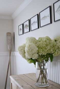 Love the ink fish artwork, oars, plank-topped entry table, and hydrangea centerpiece! My Crafty Home Life: Hydrangea Centerpieces Decoration Design, Decoration Table, Coastal Style, Coastal Decor, Oar Decor, Modern Coastal, Coastal Colors, Coastal Curtains, Coastal Entryway