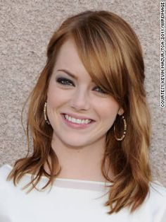 Hair color? Coppery auburn with strawberry highlights