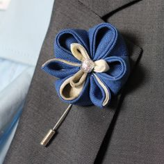 A personal favourite from my Etsy shop https://www.etsy.com/listing/186155721/royal-blue-lapel-flower-nautical-wedding