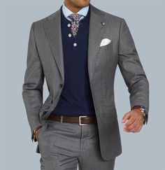 The perfect business look - Grey suit, Dark blue Henley and Floral tie. What are your thoughts on this outfit? www.Grandfrank.com