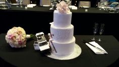 An unusual personal touch on this couples cake,  but so cute!