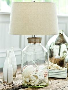 Clear Glass Table Lamp Filled with Shells: http://beachblissliving.com/beach-lamps-and-pendant-lights/