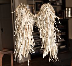 One of the most unique crafts I've seen made from vintage books.... angel wings! renaissancewyoming.blogspot.com
