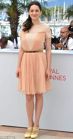 Rust and Bone photocall: Marion Cotillard looked lovely in a pale pink dress today at Cannes