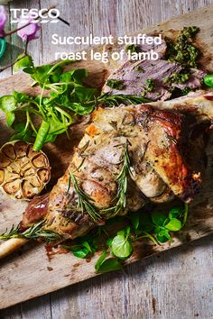 Serve up this succulent roast leg of lamb for a Sunday roast to remember. Full of fresh spring flavours from a watercress and garlic stuffing and buttery new potatoes, this centrepiece will make the ultimate Easter lunch. | Tesco
