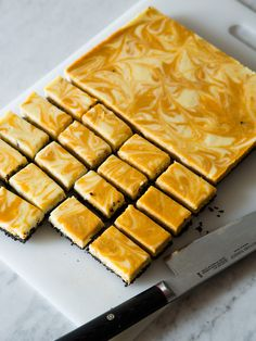 marbled pumpkin cheesecake bars with a chocolate wafer crust