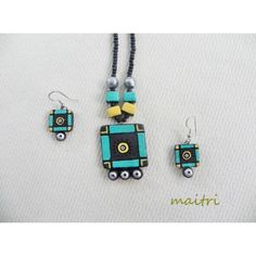Blue Cart_Terracotta Jewellery    Product type : Terracotta Handmade    A simple yet elegant handmade terracotta necklace set, with earrings, in bright blue and dull yellow color with a unique design, done in a very contemporary taste !     Terracotta products are done by local artisans using simple natural methods !    Cost : Rs 484    maitri_crafts@yahoo.com  http://www.facebook.com/maitri.crafts