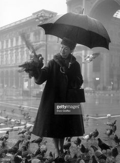 Prima ballerina Margot Fonteyn (1919-1991) feeding the pigeons in the Duomo Square, Milan. She is currently performing in 'The Nutcracker Suite' at La Scala.