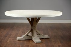 round  dining table with wood base - with a glass top