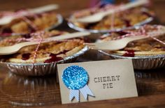 mini pies tied with wooden fork and baker's twine...also like the food labels but with just a plain ribbon embellishment