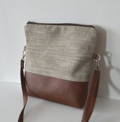 This shoulder / crossbody bag is handmade of upholstery fabric and distressed brown faux leather. Perfect everyday bag. Closes with a zipper. The