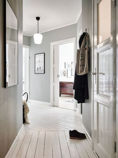 Struggling to decorate your long, narrow hallway? We have 19 long narrow hallway ideas that range in difficulty. From painting one wall to adding a long runner, we've got you covered. Turn your hallway into a library, or add shoe storage. Hallway Flooring, Wooden Flooring, White Flooring, Painted Wooden Floors, White Painted Floors, Painted Floorboards, White Wooden Floor, Decoration Inspiration, Interior Inspiration