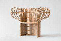 A New Layer II is a minimalist bamboo chair created by Tokyo-based designer Jin Kuramoto. By combining both the handmade bamboo bending process to the natural indigo-dyed technique normally applied to.