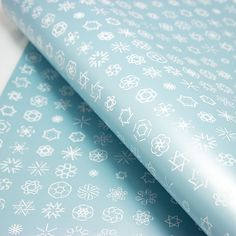 Wrapping paper with snowflakes, each made of 6 letters or numbers