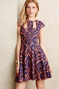 Love the cutouts on this dress (front and back). Might not be the right pattern/colors for me.