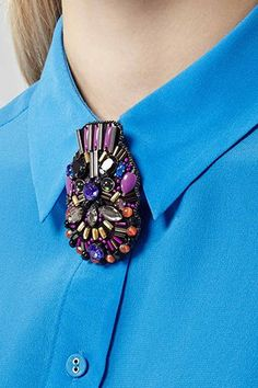 Seen on the spring '14 Givenchy runway, in concert on Kanye West's face, and now fastened to your favorite work shirt — behold the mask. (We happen to like it as a surprising accent, in jeweled-brooch form most.) #refinery29 http://www.refinery29.com/60195#slide-16