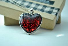 This pendant is made with a 25mm glass heart cabochon (25mm = 1 inch), set in a silver heart setting. It hangs on an 16-20 adjustable handmade
