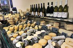 Soft and artisan cheeses are displayed in one case at Fromagerie Deruelle gourmet cheese shop in Bordeaux, France
