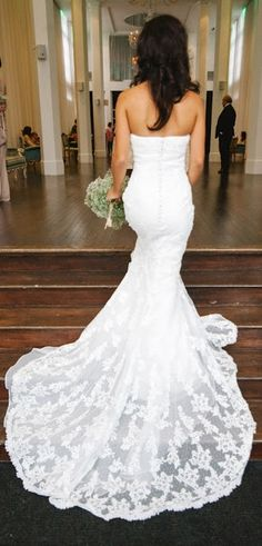 Lace strapless fitted wedding dress.  I love the long lace train!