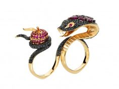 Stephen Webster - Temptation of eve ring mounted on rose gold displays a serpent set with black diamonds holding a ruby studded apple