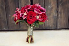 Red and hot pink rose, orchid, and calla bridal bouquet. Photo: Kelly Rucker Photography.
