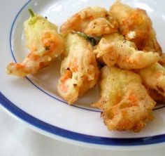 Tempura goat cheese and ricotta stuffed pumpkin blossoms by Lucy Mercer/A Cook and Her Books   If you ever talk to someone wh. Beer Recipes, Pumpkin Recipes, Cooking Recipes, Healthy Recipes, Delicious Recipes, Tempura, Pumpkin Blossom Recipe, Fried Goat Cheese, Gastronomia