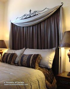 I love the idea of curtains as a head board  This is what I want to do only have it higher.
