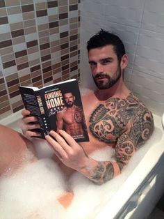 One day Stuart Reardon will read a book I've edited and cover I've created with him on it. He will not be reading it in a tiny bath.