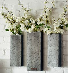 Galvanized planters could go on the wall beside the wood stove