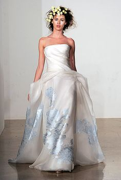 I love the light blue.. it adds something like water to the whole look. I would like to see what the material looks like up close.