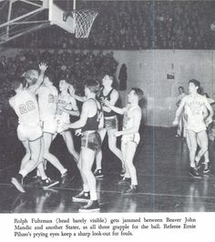 """Oregon varsity basketball player Bill """"The Goon"""" Borcher fights for the ball vs. Washington State 1940.  From the 1941 Oregana (University of Oregon yearbook).  www.CampusAttic.com"""