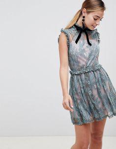 35e323ca86 ASOS DESIGN Petite lace skater mini dress with velvet tie neck at asos.com