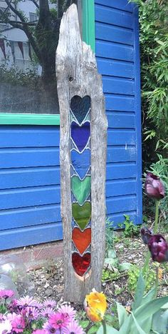 Beautiful garden art! #stainedglass #heart #rainbow