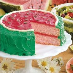 Easy summer watermelon cake recipe. This pretty cake makes a perfect summer picnic and potluck dessert, from Memorial Day through Labor Day.