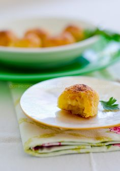 Baked ripe plantain balls filled with Mozzarella and covered with Parmesan. Totally addictive.