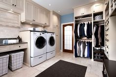Exquisite Award Winning home renovations Traditional Laundry Room Toronto home insurance built-in storage cabinets drawers drying rack hampers laundry room laundry room appliances NKBA shoes vertical shoe rack - Decorcology.com