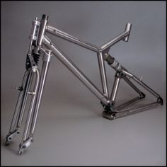The main frame is titanium and the suspension fork is chrome-moly steel and aluminum. Velo Design, Bicycle Design, Mountain Bike Frames, Mountain Biking, Bici Retro, Bicycle Garage, Montain Bike, Velo Cargo, Full Suspension Mountain Bike